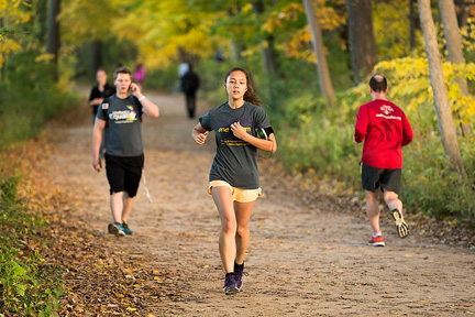 Pedestrians and runners share in the natural beauty of the leaf-covered Howard Temin Lakeshore Path at the University of Wisconsin-Madison during autumn on Oct. 16, 2014.