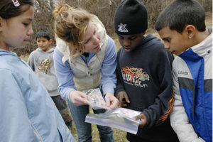 University of Wisconsin-Madison undergraduate Mary Blitzer and a group of student volunteers (off camera), lead a group of fourth- and fifth-grade students from Lincoln Elementary School on a scavenger hunt on March 23, 2007, at Picnic Point on the UW-Madison campus.